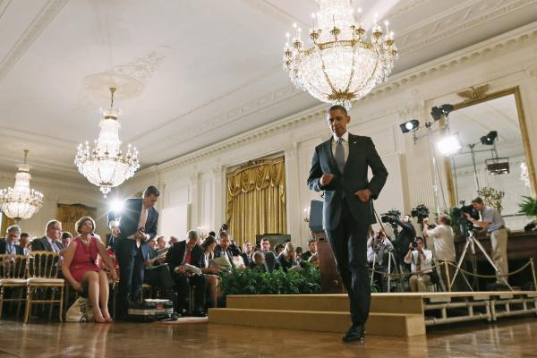 President Obama walks out of the East Room of the White House after holding a news conference Friday.
