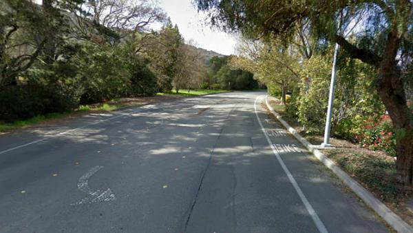 A stretch of Foothill Road in Pleasanton, Calif., near where police say Cody Hall, 18, lost control of his car and struck two cyclists. One cyclist died, and Hall was charged with murder this week.