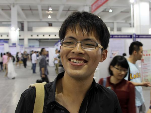 Hou Feng, who graduated from Shanghai Maritime University, has been offered some entry-level jobs, but he's holding out for something more prestigious.