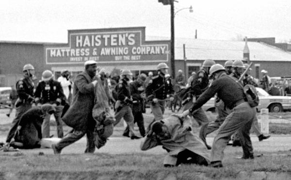 State troopers beat Lewis (in foreground), then-chairman of the Student Nonviolent Coordinating Committee, during a voting rights march in Selma, Ala., on March 7, 1965.