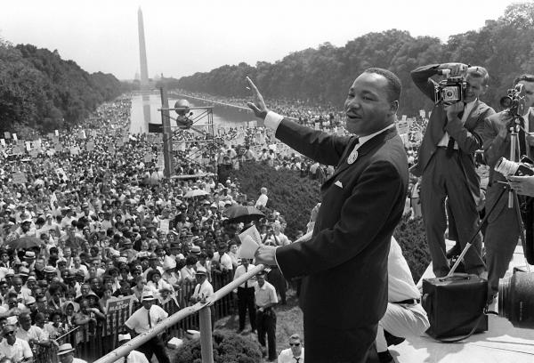Civil rights leader Martin Luther King waves to supporters from the steps of the Lincoln Memorial on Aug. 28, 1963, in Washington.