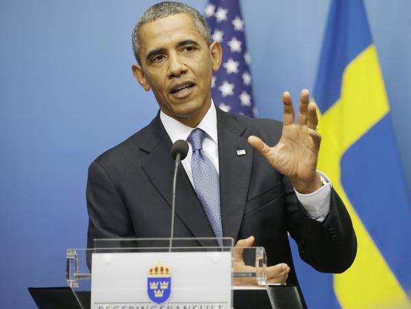 President Obama gestures during his joint news conference with Swedish Prime Minister Fredrik Reinfeldt on Wednesday in Stockholm. The president said the credibility of the international community, Congress and America is on the line with the response to Syria.