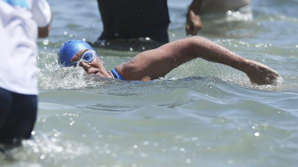 Long-distance swimmer Diana Nyad swims toward shore in Key West, Fla., on Sept. 2, the first person to swim from Cuba to Florida without the help of a shark cage. She arrived at the beach about 53 hours after beginning her swim in Havana.