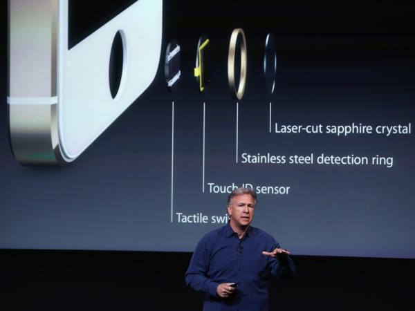Phil Schiller, Apple's senior vice president of worldwide marketing, speaks about fingerprint security features of the new iPhone 5s Tuesday in Cupertino, Calif.
