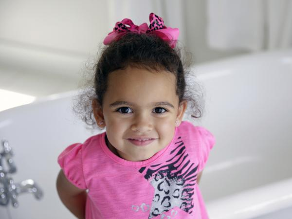 Veronica, the child at the center of an adoption dispute, smiles in the bathroom of the Cherokee Nation Jack Brown Center in Oklahoma.