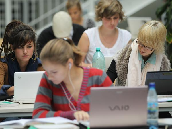 Students studying on their laptops in Berlin. Writer Clive Thompson says that actively engaging with computers is making students better writers.
