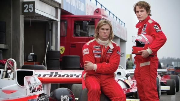 The radically different Formula One racers  James Hunt (Chris Hemsworth, left) and Niki Lauda (Daniel Bruhl) are at the center of Ron Howard's <em>Rush</em>, a biographical drama that's as strong on character as on cars.