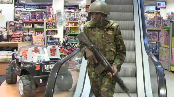 Kenyan soldiers secure a section of Nairobi's upscale Westgate Mall, in this image taken from AFP TV. At least 68 deaths have been reported as a result of Saturday's midday attack by gunmen at the mall.