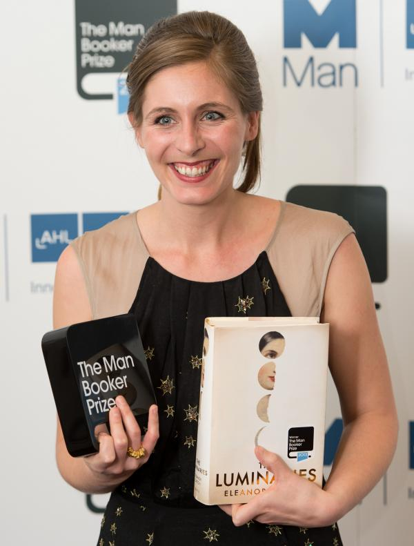 Eleanor Catton, author of <em>The Luminaries</em> poses for photographs Tuesday after winning the 2013 Man Booker Prize for Fiction at The Guildhall in London.