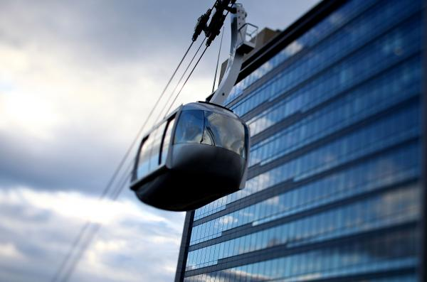 Commuters headed to Oregon Health and Science University use cars, bikes and streetcars to connect with Portland's aerial tram, which whisks them up and over south waterfront neighborhoods.