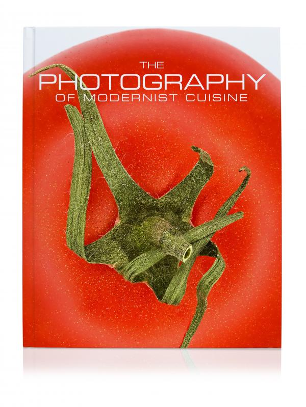 By the numbers: <em>The Photography of Modern Cuisine</em> contains 405 photos on 312 pages. It weighs 12.1 pounds and when you flip through it, the wingspan is more than 2 feet.