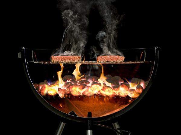 To capture the magic of grilling, the team at The Cooking Lab sawed a Weber grill in half and then combined 30 photographs together.