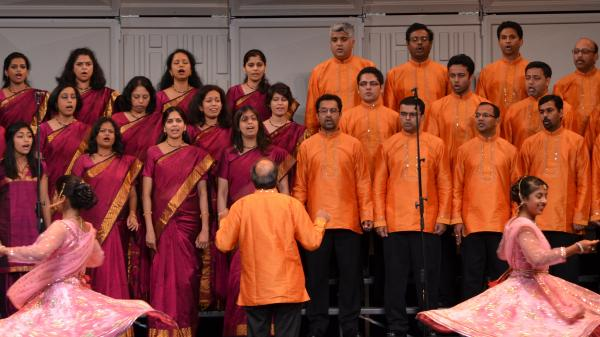 Kanniks Kannikeswaran leads the Greater Cincinnati Indian Community Choir in 2012, as it competes at the World Choir Games in Cincinnati.