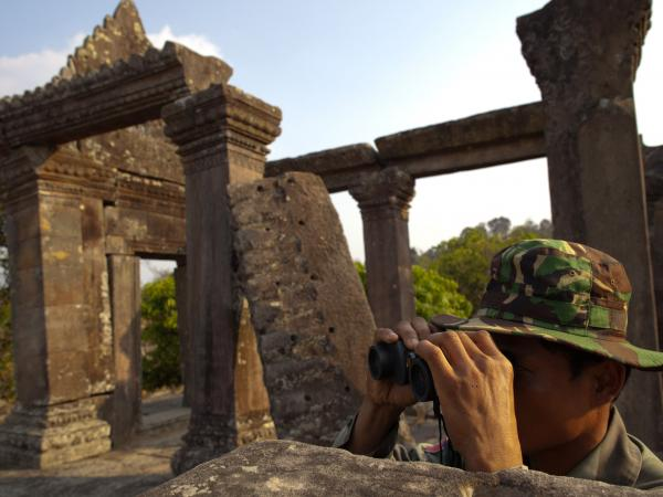 A Cambodian soldier looks across at the Thai border from the ancient Preah Vihear temple complex in Feb. 2011.