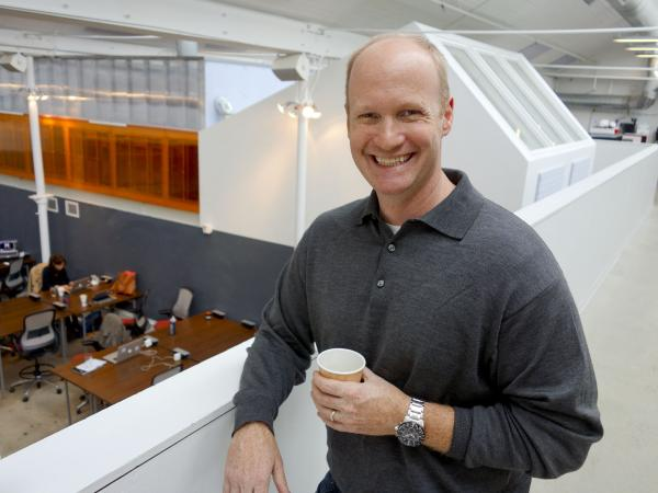 Galvanize co-founder Chris Onan holds a cup of Galvanize's signature coffee.