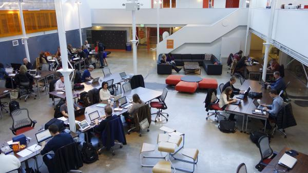 The main atrium of Galvanize allows freelancers to work or come and go as they please, for a monthly membership fee.