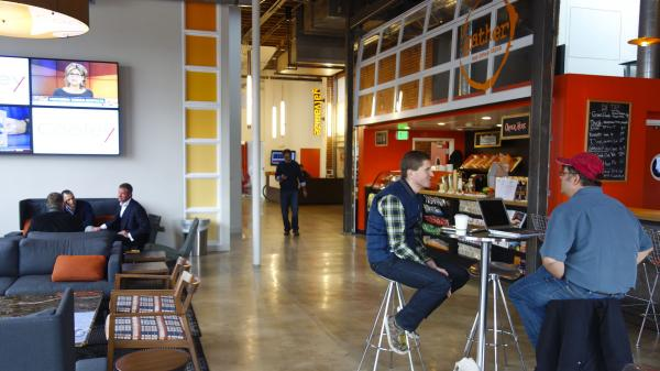 The lobby entrance to Galvanize is a bar and a coffee shop.