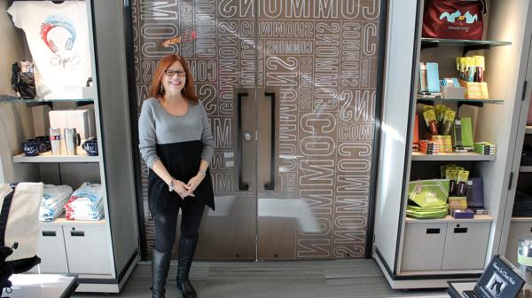 NPR Shopkeeper Barbara Sopato poses inside The Commons at NPR HQ.