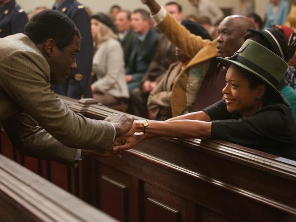 Idris Elba (as Nelson Mandela) and Naomie Harris (as Winnie Mandela) in a scene from his trial.