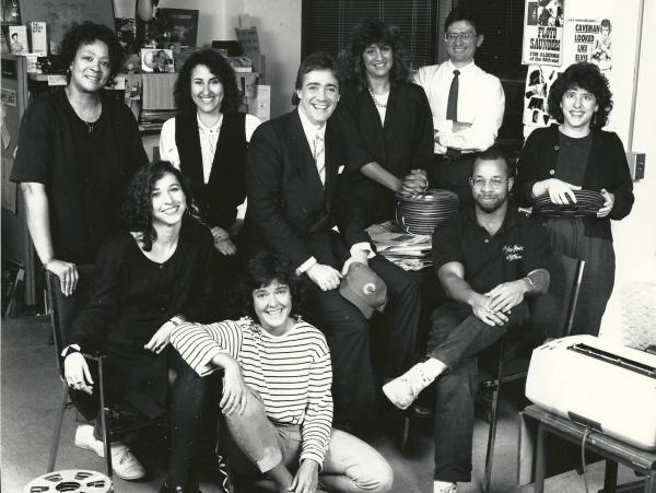 <em>Weekend Edition Saturday</em> staffers, photographed at NPR's former M Street headquarters, in Washington, D.C. Top left: (the late) Marta Haywood, Cindy Carpien, Scott Simon, Laura Ziegler, Steve Tripoli. Bottom left: Mandalit del Barco, Liz Buechel, Doug Mitchell, Neva Grant