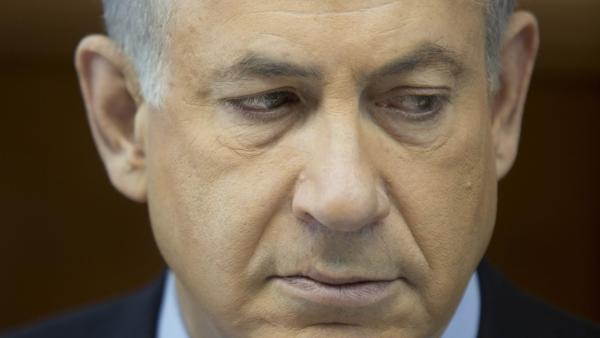 Israeli Prime Minister Benjamin Netanyahu attends the weekly Cabinet meeting at his office Sunday in Jerusalem. Netanyahu says world powers gave away too much for too little in the interim deal reached last weekend with Iran over its nuclear program.