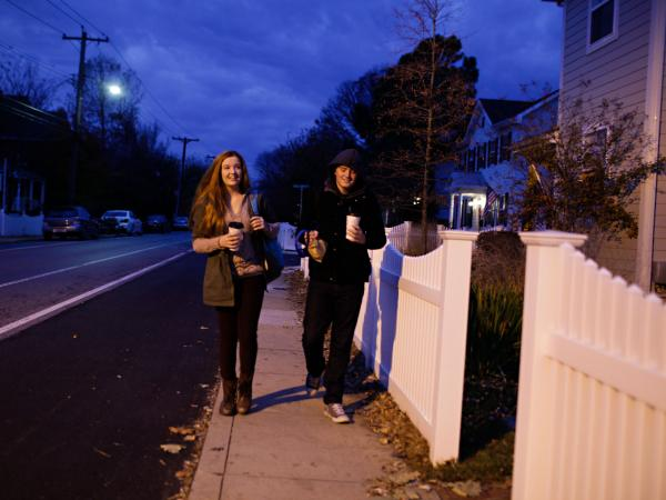 Lily and Isaac walk to catch the bus at 6:35 in the morning.