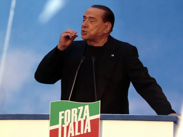 Former Italian Prime Minister Silvio Berlusconi gestures during a speech to supporters Wednesday in Rome.