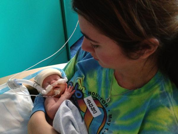 Madison Fitzgerald, 20, holds her baby, Jake, in the neonatal intensive care unit at Texas Children's Hospital in Houston. Jake, who was born 16 weeks too early, receives donor breast milk every three hours by mouth.