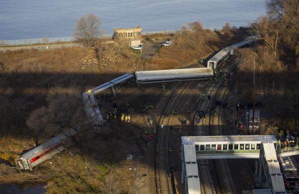 First responders gather around the derailment of a Metro North passenger train in the Bronx borough of New York on Sunday.