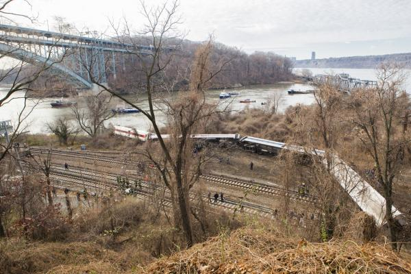 The seven-car train left the tracks about 7:20 a.m. as it was heading to Grand Central Terminal in New York City.