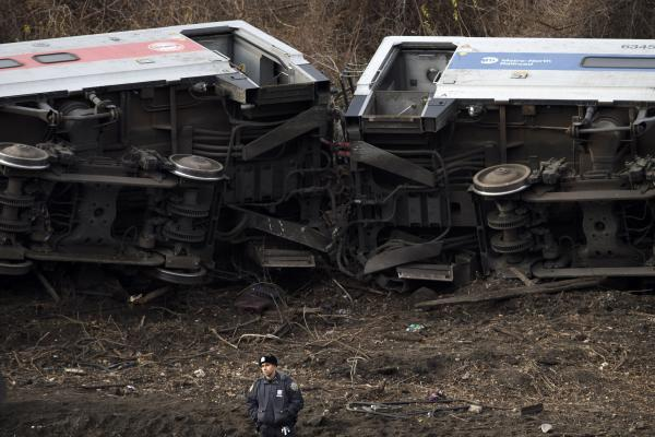 At least two of the cars were rolled onto their sides along the tracks. The train derailed near the Spuyten Duyvil station.
