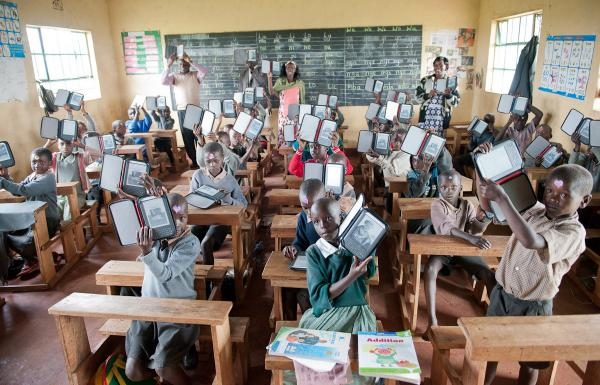 "Students at Ntimigom School in Kilgoris, Kenya, show off their e-readers. <a href=""http://www.worldreader.org/"">Worldreader</a> now operates in 27 schools and two libraries in Kenya."