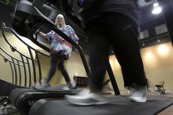 Gym members warm up on treadmills at Downsize Fitness in Addison, Texas. Membership at the gym is limited to people who have a high body mass index.