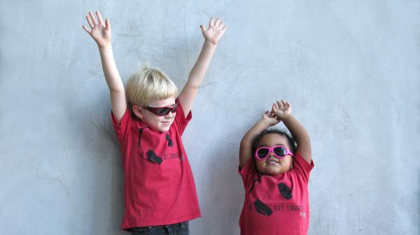 Rocking the NPR Get Smarter t-shirt for NPR West are (l to r) Hadley Hamilton-Lowe, son of Operations Desk's Angie Hamilton-Lowe, and Amaya del Barco, daughter of Correspondent Mandalit del Barco. These Hollywood kids have paired their shirts with some cool shades and attitude.
