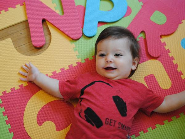 And from the Washington, D.C., bureau, Media Relations Director Anna Bross' daughter Evie shows us that you don't have to have celebrated your first birthday yet to have a whole lot of style. She mixed materials and paired her Get Smarter shirt with a colorful, foam play mat.