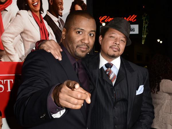 Director Malcolm Lee (left) and actor Terrence Howard on the red carpet for the world premiere of their movie, <em>The </em><em>Best Man Holiday.</em>