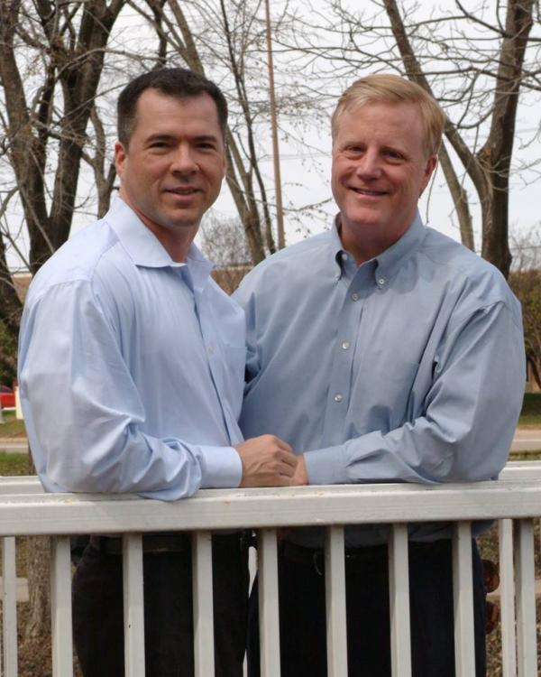 Mark Phariss (red hair) and his partner Vic Holmes, two of the main plaintiffs in the Texas.