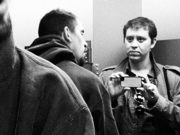 Photographer Chris Capozziello takes a photo of his brother, Nick.