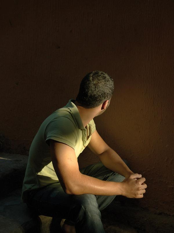 Hamada, 21, narrowly missed being forced into the army when a guard who had caught him at a checkpoint turned away to tend to something else. At that same moment, rebel fighters shot and killed the guard and Hamada was able to run away. Like his friend Tamer, he lives in a dark, tiny room on the outskirts of Beirut with four other refugees. His parents urged him to leave Syria because they were afraid he would be conscripted. He left the country using the identity of his youngest brother who wasn't of army age. He's been in Lebanon for six months and says that he is emotionally destroyed, depressed, scared and worried about how to pay the rent, how to eat, how to get by. (Elena Dorfman)