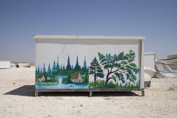 A dreamscape on the outside of living quarters in the Zaatari refugee camp in Jordan. (Elena Dorfman)