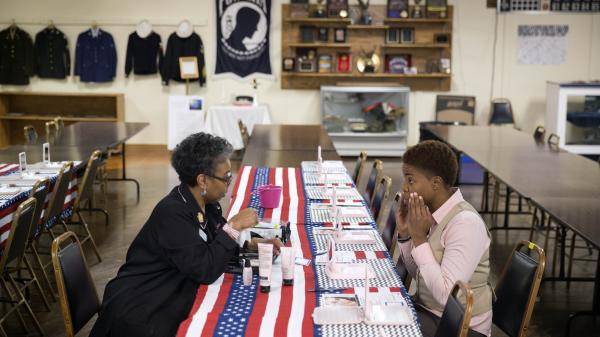 Air Force Staff Sgt. Bri Smith (right) of Atlanta talks with a Mary Kay consultant during a November job fair for veterans.