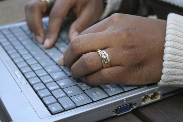 The hands of this ostensibly black stock photo model might be coding on an open-source project. But probably not.
