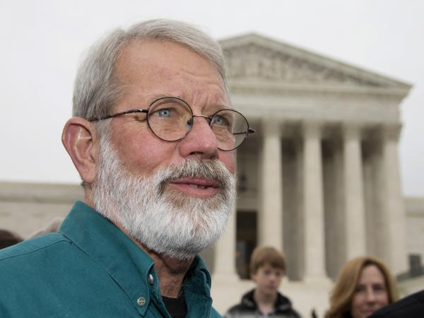 John Dennis Apel speaks outside the Supreme Court on Wednesday, after oral arguments in his case. The justices are considering whether Apel has the right to protest at a military base.
