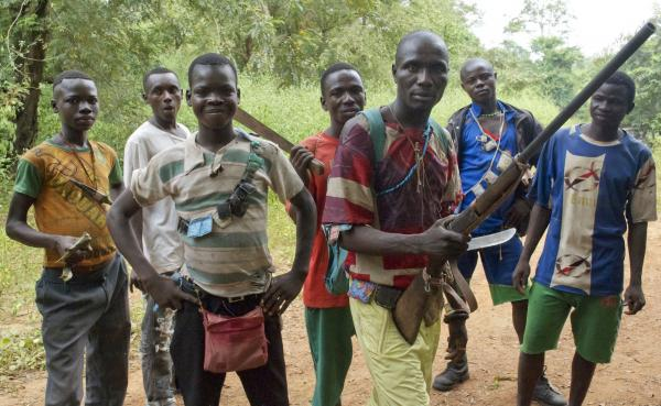 Fighters from a Christian militia known as the anti-balaka have emerged to defend towns and in some cases attack Muslim communities. These men display their makeshift weaponry in Boubou, Central African Republic, on Nov. 26.
