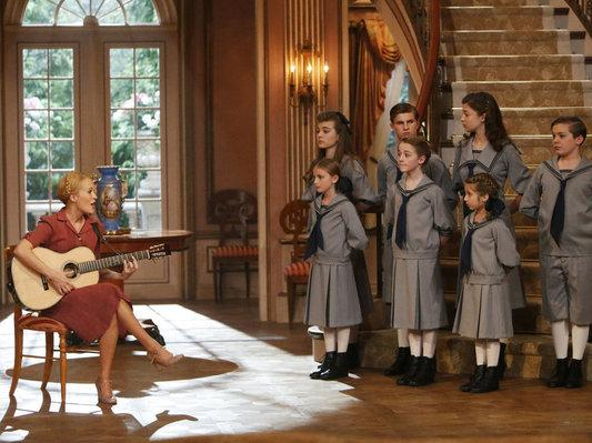 Carrie Underwood as Maria, with (back, from left) Ella Watts-Gorman as Louisa, Michael Nigro as Friedrich, Ariane Rinehart as Liesl, Joe West as Kurt and (front, from left) Grace Rundhaug as Marta, Sophia Ann Caruso as Brigitta and Peyton Ella as Gretl, in NBC's live production of <em>The Sound Of Music</em>.