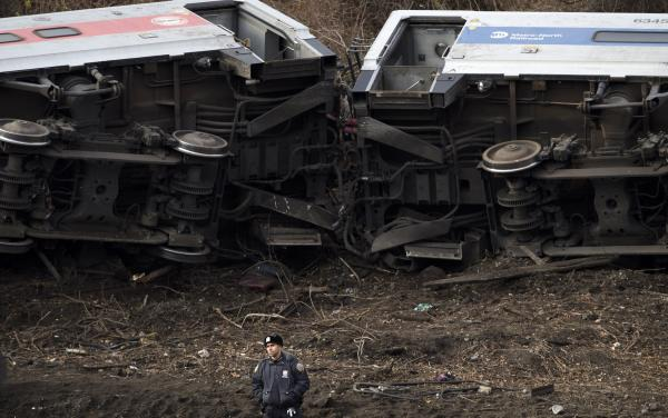 A police officer stands guard at the scene of a Metro-North passenger train derailment in the Bronx borough of New York on Dec. 1.