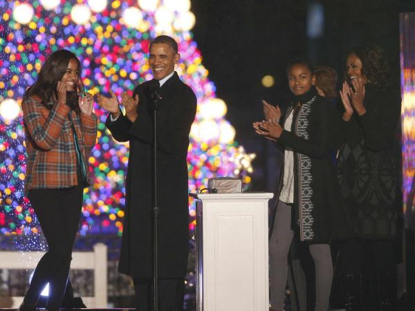 President Barack Obama, first lady Michelle Obama, daughters Sasha and Malia, applaud after lightng the National Christmas Tree at a ceremony across from the White House in Washington, on Friday.