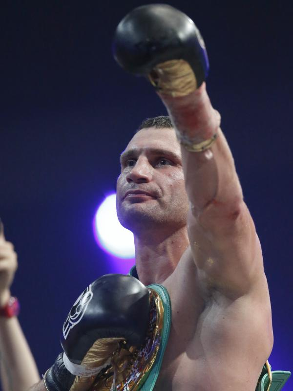 Klitschko celebrates his win over Manuel Charr of Germany during their WBC bout for the heavyweight title in Moscow on Sept. 9, 2012.