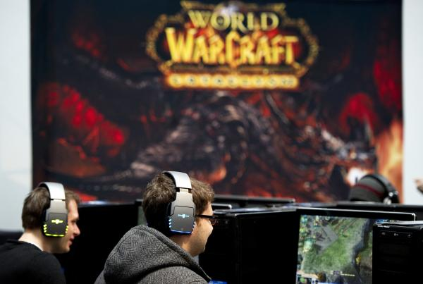 Gamers play at an IT fair in Germany. The NSA and a British counterpart have deployed agents into several virtual worlds, according to reports, including the online game World of Warcraft.