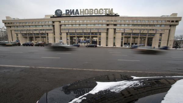 Cars pass by the RIA Novosti information agency headquarters in Moscow on Monday. President Vladimir Putin named Dmitry Kiselyov, a controversial news anchor known for his ultraconservative views, to head a newly restructured state news agency.